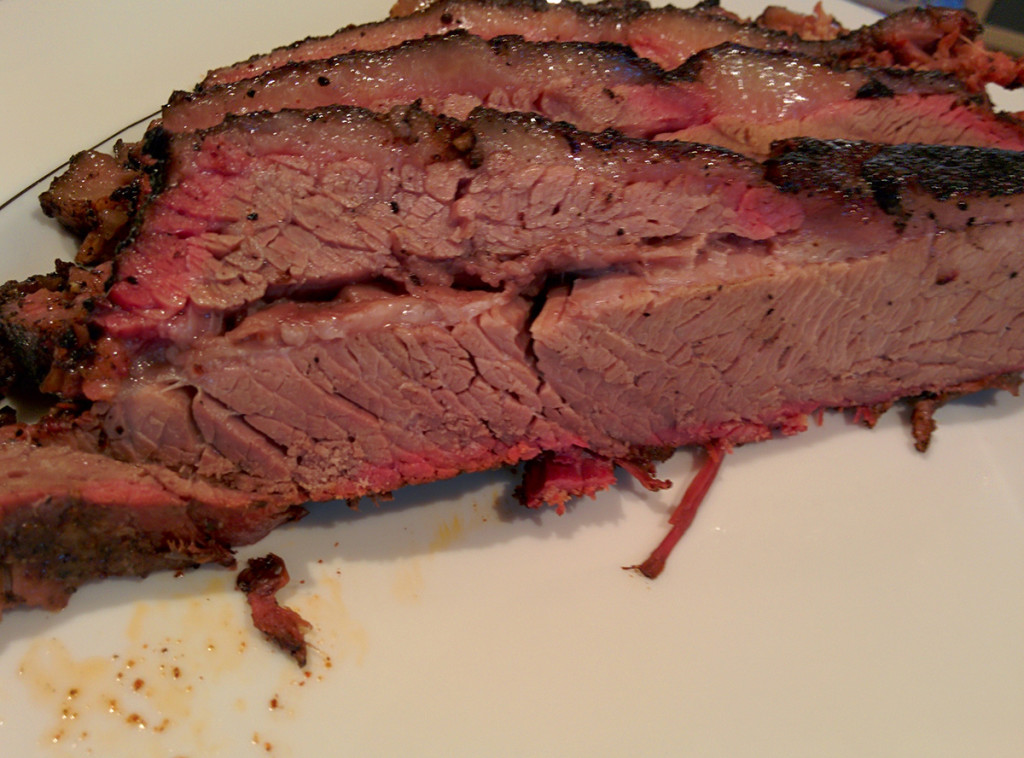 Slices of sous vide prepared smoked bbq brisket